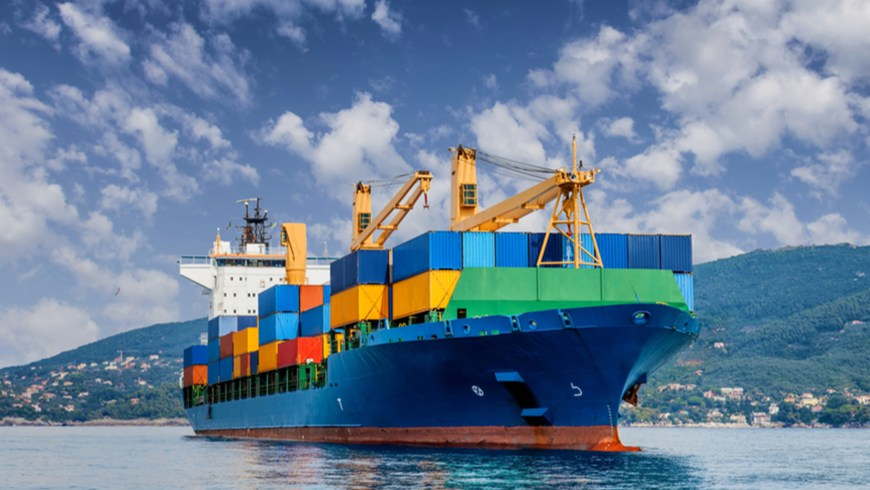 Cargo ship with mountains in background