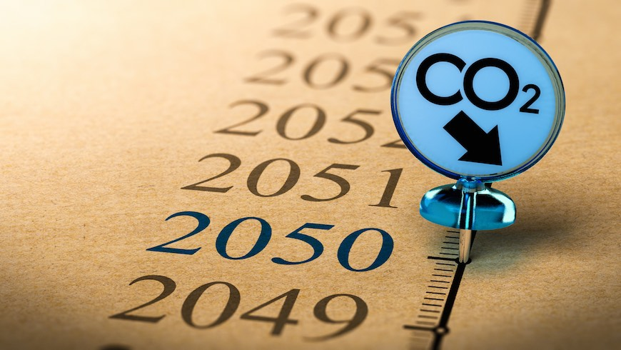 Special Pushpin with the text co2 pined on a timeline in front of the year 2050. Concept of climate plan and carbon dioxide reduction.