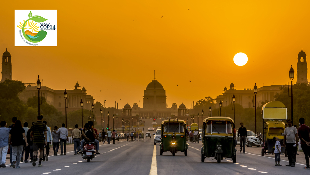 Sunset over New Delhi, India overlayed with UNCCD COP14 logo