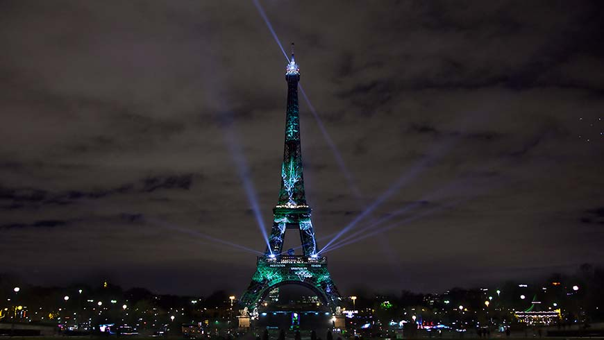 Art installation lights up Eiffel Tower on eve of Paris Climate talks. Photo: Elfred Tseng/Shutterstock.com