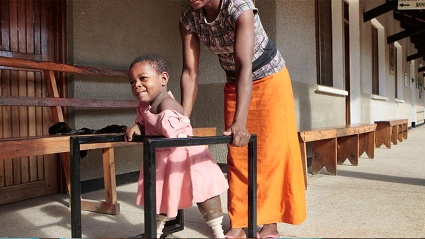 Disabled child trying to walk.