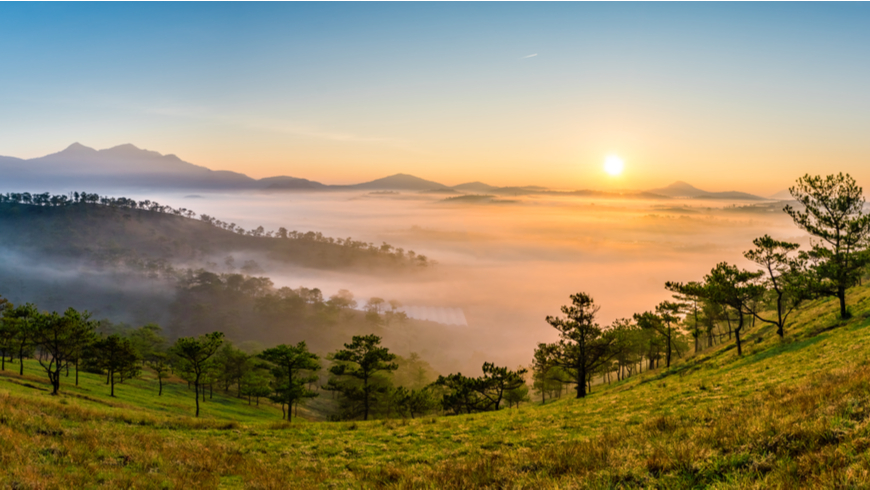 Sunrise near Da Lat City, Vietnam overlooking mountains and forests