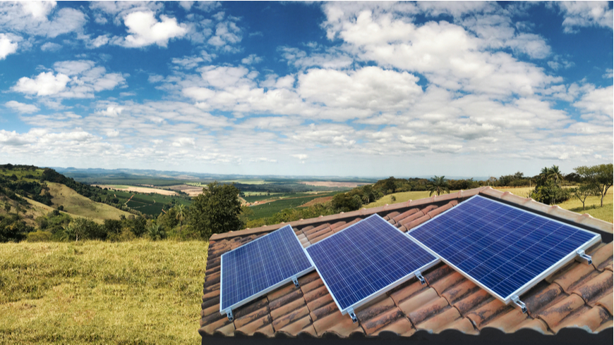 Solar panels on roof with mountain and valley landscape in background