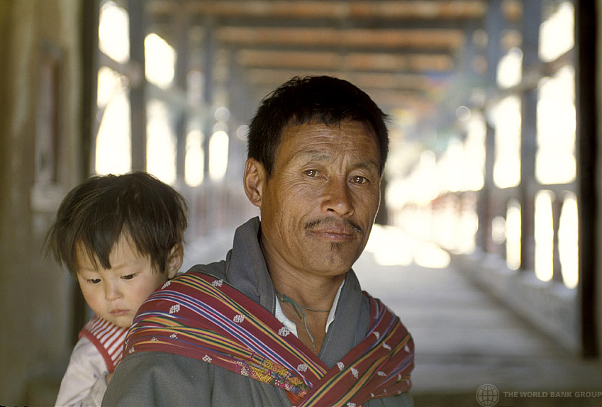 Portrait of man carrying child in Bhutan