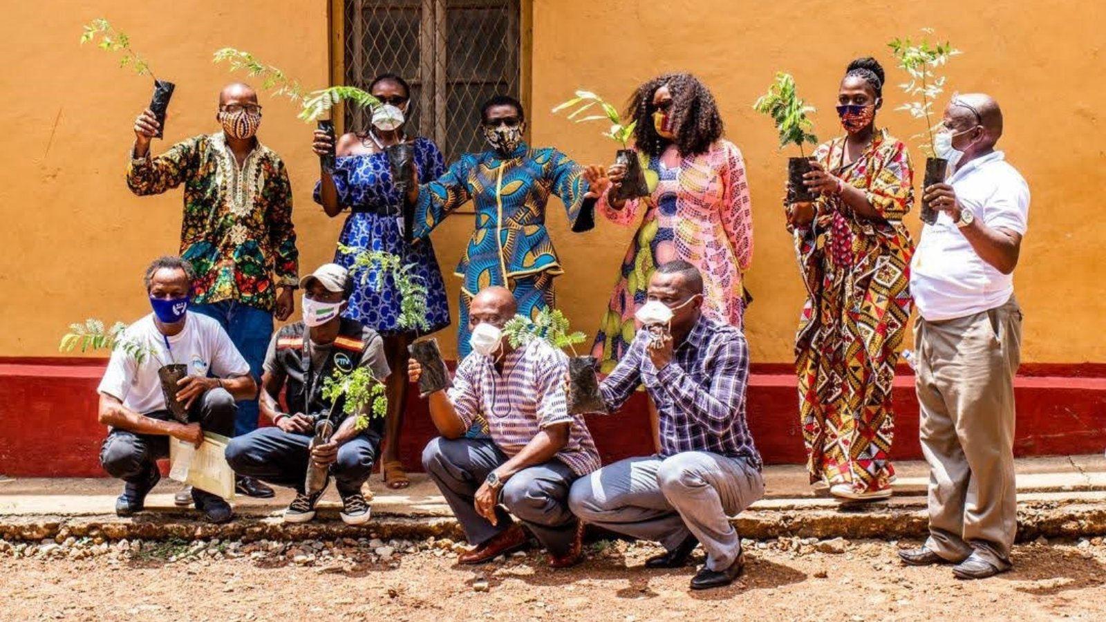 Residents of Freetown, Sierra Leone, show off tree planters