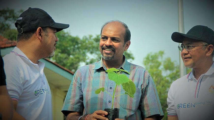 Dr. Nagulendran Kangayatkarasu at a tree planting event