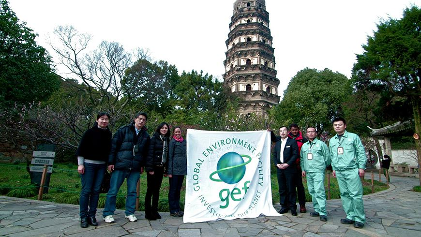 GEF and project staff stand in front of a pagoda at Suzhou's Tiger Hill, which was a demonstration site using safe alternatives to Mirex and Chlordane to prevent termite infestations and protect cultural heritage sites. Since 2009, China has banned production of toxic chemicals, including Mirex and Chlordane, which had previously been the preferred method of pest control at such sites.