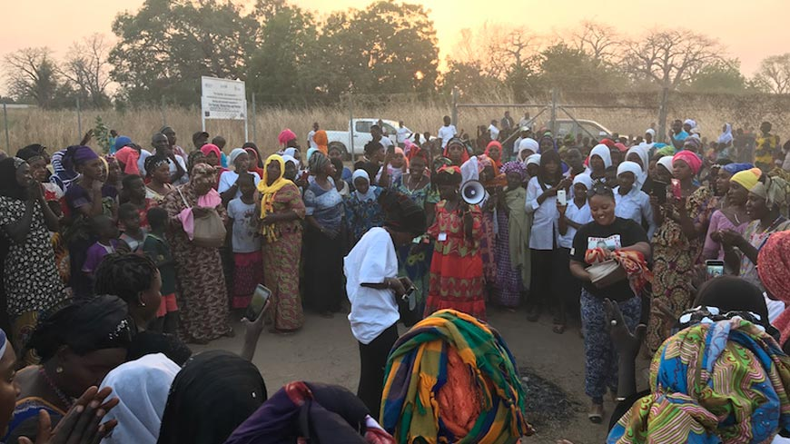 People gathered at sunset to participate in a community event