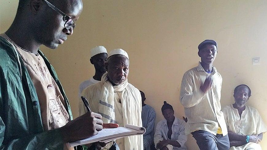 GEF IEO team member interviewing Senegalese farmers