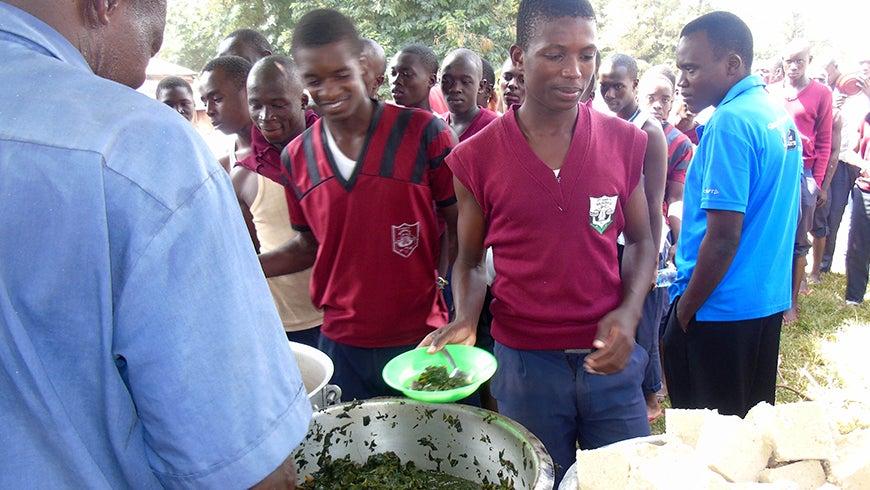 Kenyan students eating indigenous vegetables