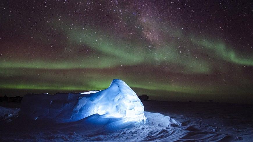 Aurora Australis and LED illuminated igloo
