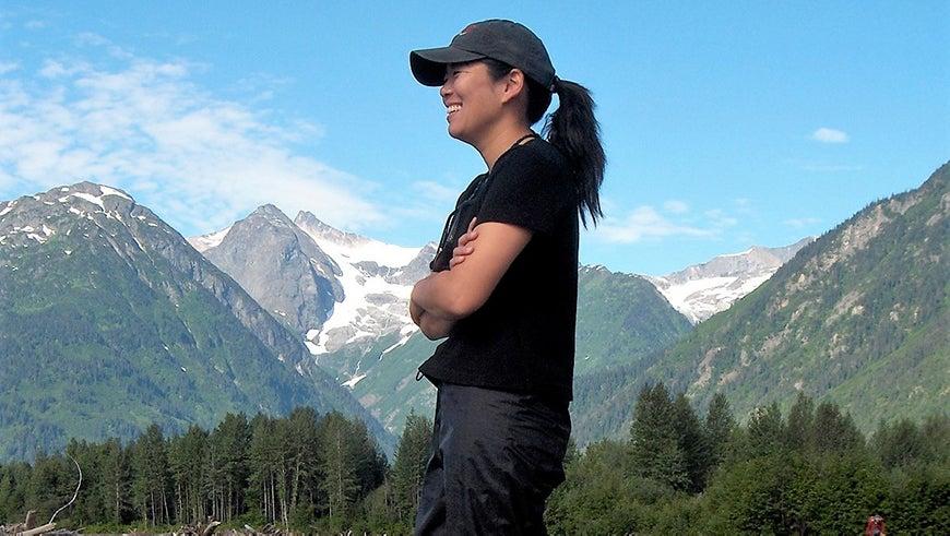 Aileen Lee portrait in front of a mountian landscape