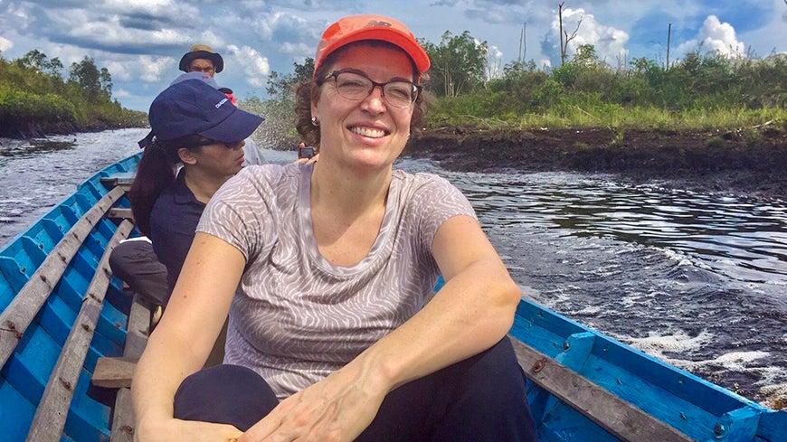 Karin Kemper on a boat near Kalimantan, Indonesia