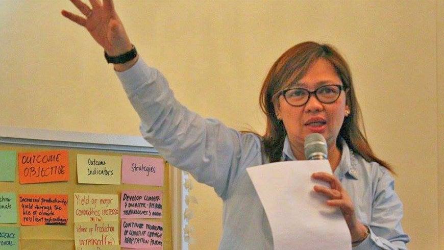 Anna Teh speaking at a workshop