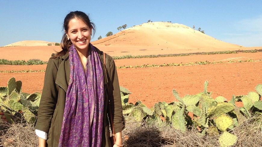 Milena Gonzalez Vasquez in front of a Moroccan landscape