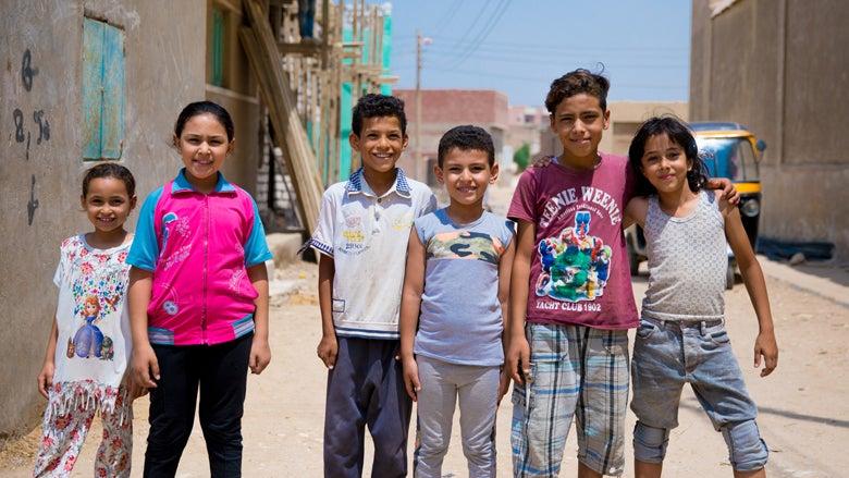 Smiling children in group photo, El-Saf, Egypt