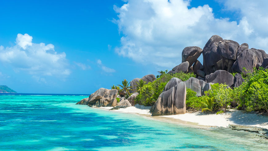 granite rocks at beautiful beach on tropical island La Digue in Seychelles. Photo: Simon Dannhauer/Shutterstock.