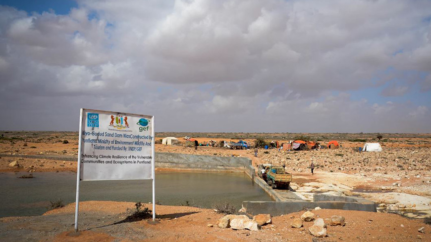 A sand dam is a reinforced rubble cement wall built across a seasonal sandy river. The sand dam is part of  the GEF-funded Enhancing Climate Resilience of Vulnerable Communities and Ecosystems in Somalia project. Photo credit: Said Isse, UNDP Somalia