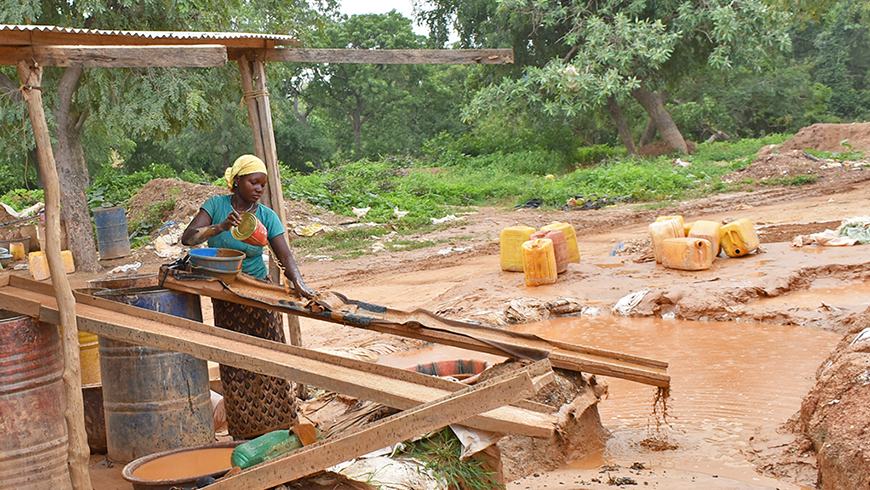 Woman processing gold in Burkina Faso