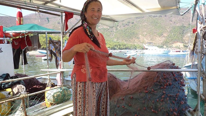 Turkish fisherwoman with nets