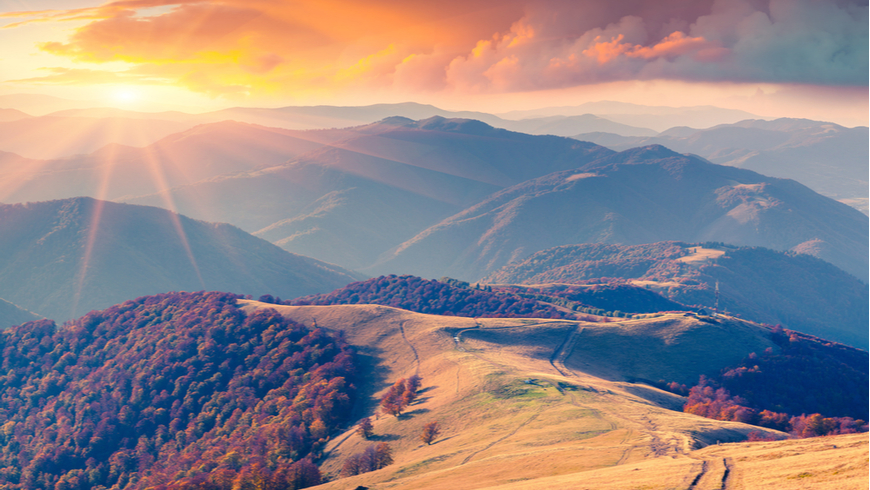 Colorful autumn sunrise in the Carpathian mountains. Krasna ridge, Ukraine, Europe.
