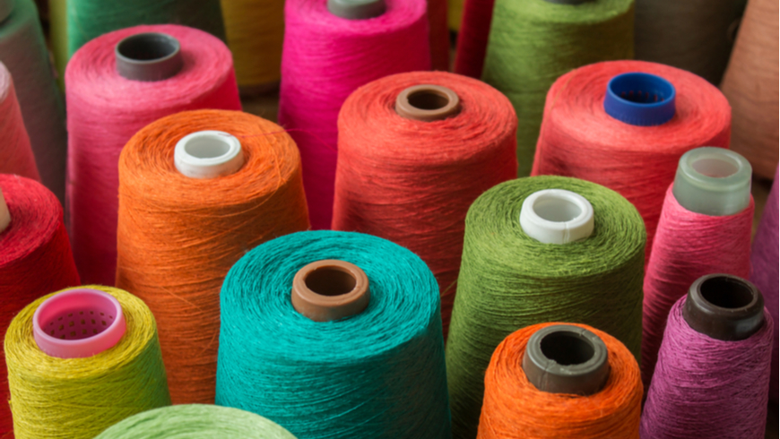 Colorful spools of fabric