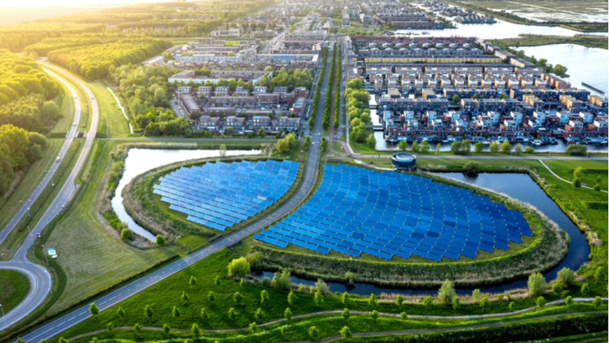 Modern sustainable neighborhood in Almere, The Netherlands. The city heating in the district is partially powered by a solar panel island. Aerial view.