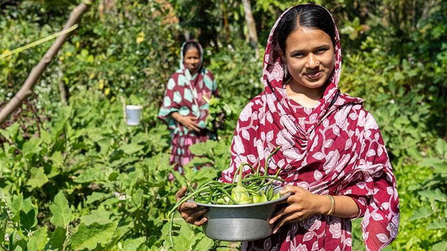 Bangladeshi woman holding crop haul