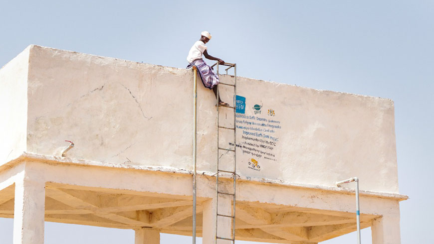 Somali man atop platform and ladder
