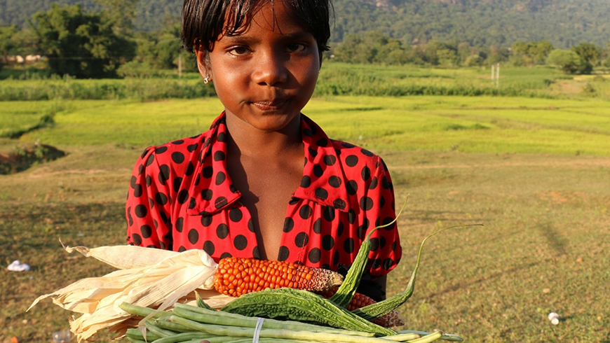 Girl holding crops