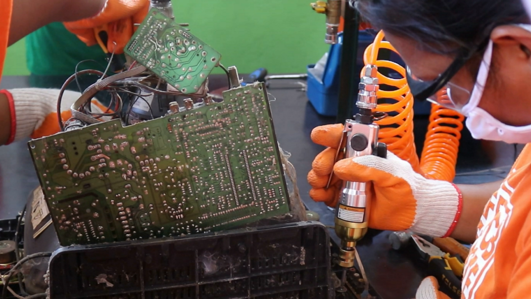 Workers recycling e-waste