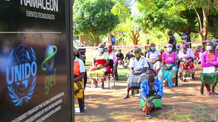 Mozambican women sit for a tablet presentation
